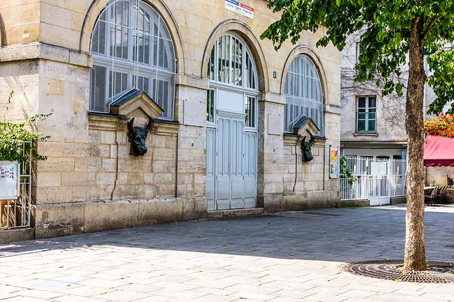view of the fontaine from the halle des blancs manteaux