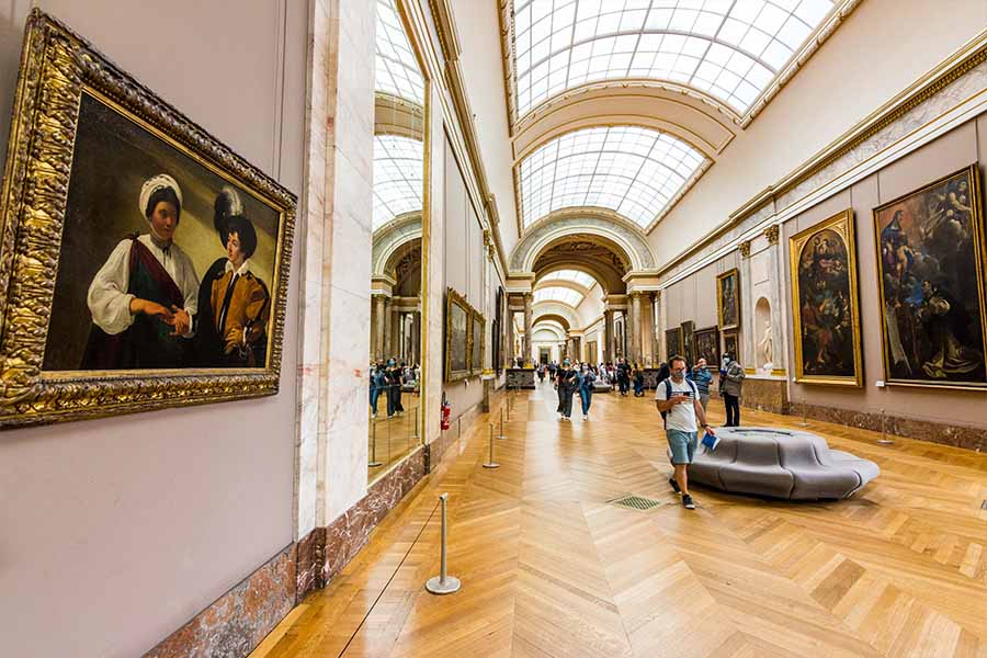 grande galerie in the Louvre and the Fortune Teller painting by Caravaggio